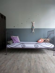 Wrought iron bed from Atelier Charivari for vintage feel