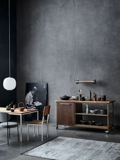 There is something tres chic about a dark, contemporary, minimalist kitchen design