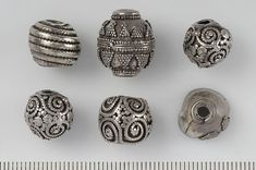 Viking silver beads from Tolsta/Torsta; Häsingtuna, Hälsingland, Sweden. (Historiska Museet)
