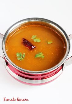 tomato rasam recipe (no dal) with step by step photos. Easy to make, needs no grinding, South indian style tomato rasam / tomato charu to accompany rice