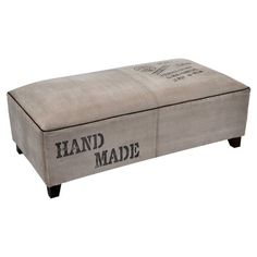 Perfect placed in your entryway or for resting a tray of cocktails in the living room, this handsome bench is wrapped in canvas and adorned with carte postal...