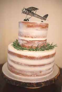Beautiful half-naked airplane cake for a travel-themed birthday party.