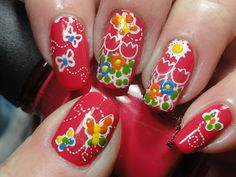 Reminds me of Holland...  flower & butterfly nail art