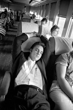 Elvis Naps on the Southern Railroad -   Between Chattanooga and Memphis, Elvis doesa variety of things among which is to take small naps. Here he is doing just that. Later that night he will perform before 14,000 people atRusswood Park. July 4, 1956.