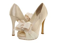 rsvp Cailyn  http://www.zappos.com/rsvp-cailyn-ivory  $99.00  but in the light blue/green color