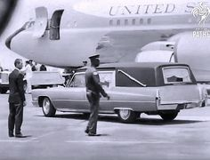 June 6, 1968: A hearse bearing Robert Kennedy's casket arrives near Air Force Two, at Los Angeles Airport.