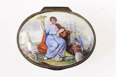 A rare mid-18th˜Century English Staffordshire enamel patch box Depicting Britannia seated holdin