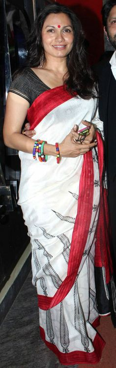 You can't go wrong with a white saree with the red border!