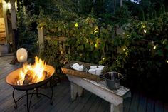 Cozy outdoor space, fire pit, lights in bushes