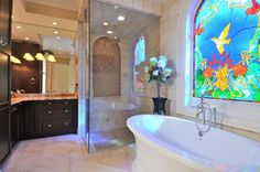 Brilliant idea: stained glass in the bathroom. Catches the light and still provides privacy. Balneo Naos therapeutic bathtub by @BainUltra. http://www.bainultra.com/therapeutic-baths/our-collections/balneo/naos-6636
