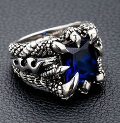 Eagle Claw Sterling Silver Mens Rings Come with sapphire blue stone.