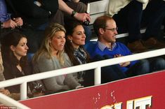 Time to relax: After a busy day of official duties in Queensland, the Duke and Duchess kicked back to enjoy the game #katemiddleton