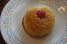 Pineapple Upsidedown Cupcakes ~ all the flavor with portion control ~ Place cherry half in paper muffin cup, cover with combination of sugar, butter, crushed pineapple and nuts; combine yellow cake mix, water and lemon gelatin package, eggs, oil, lemon zest; pour batter over pineapple mixture; bake until done, cool before serving inverted on plate and remove paper; enjoy!
