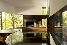 Cooper Joseph Studio designed this ultra-modern dwelling in the woods of Ghent, New York with matte black timber cladding and expansive windows. The building was intended to serve as a writers studio and from these. Interior Exterior, Interior Design, Studio Interior, Black Exterior, Living Room New York, Living Rooms, Living Spaces, Writing Studio, Studios