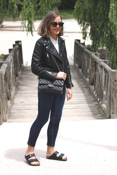 Trini  | RayBan wayfarer sunglasses, The Kooples shirt and leather jacket, Topshop jeans, Birkenstock arizona sandals and Chanel bag
