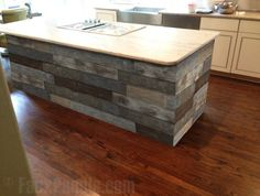 Artificial barn wood panels make any kitchen island look fantastic.