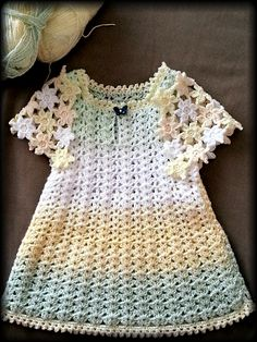 Butterfly dress. Free crochet pattern for an infant or toddler.