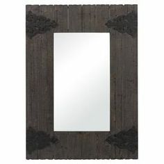 """Lend industrial-chic appeal to your entryway or parlor with this eye-catching wood wall mirror, showcasing a weathered finish and scrollwork accents.   Product: Wall mirrorConstruction Material: Wood and mirrored glass Color: Aged wood and iron frameFeatures: Scrollwork accents Dimensions: 45"""" H x 32"""" W x 1"""" D"""