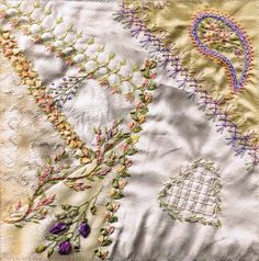 I ❤ crazy quilting & ribbon embroidery . . . COH DYOB block swap- My finished block. I used Colourstreams Ophir silk, madiera silk, YLI silk, my hand-dyed silk ribbons, & single threads of Needle Necessities variegated cotton.  Our brief was to cover seams with various stipulated stitches ( chevron, chain, feather, cretan, french knots), & a heart and a paisley shape. I have enjoyed working this block in the soft colours, & hope whoever receives it, likes it as well. ~By Following the…