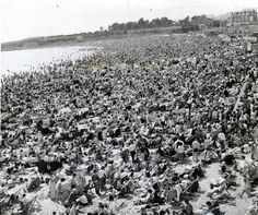 The beach is crammed with Whitsun holiday makers in 1963