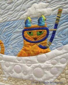 "closeup, ""Bathtub Beach"" by Sandi MacMillan (Florida).  Cat face pattern by Sheila Haynes Rauen. 2015 World Quilt Show (Florida)."