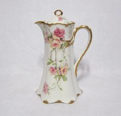 Vintage Haviland Limoges Baltimore Rose Pink/Yellow 10 Chocolate Pot Schleiger 1151 Description - This very fine pot is decorated with large pink and yellow roses and heavy gold trim. The pattern is