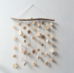 Wooden Star Mobile Wall Hanging by MadeByTheMadOnes on Etsy https://www.etsy.com/listing/197998405/wooden-star-mobile-wall-hanging