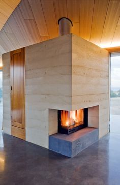 Rammed Earth fireplace...Croft by James Stockwell Architects | HomeDSGN