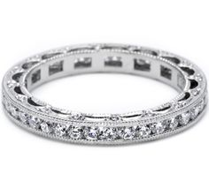 A star selection. This elegant string of channel-set diamonds snugs gracefully against its partner engagement ring. Diamonds decorate crescent silhouette details.
