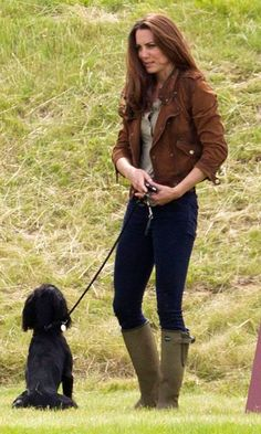 Kate's ready for fall in these hunter boots and brown cropped jacket that has just a hint of rocker edge.