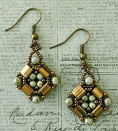 I've blogged about these cute earrings many times but I usually make them with bronze seed beads. I bought some nickel plated Tila beads jus...
