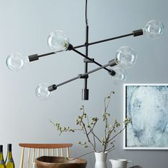 West Elm offers modern furniture and home decor featuring inspiring designs and colors. Create a stylish space with home accessories from West Elm. Mobile Chandelier, West Elm Chandelier, Chandelier, Light Decorations, Decor, Home Lighting, Chandelier Lighting, Kitchen Lighting Over Table, Light Fixtures
