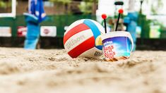 6 Best Bars to Play Sand Volleyball in the Chicago Area | UrbanMatter Sand Volleyball Court, Volleyball Games, Chicago Bars, West Chicago, Places In Chicago, Chicago Restaurants, Cubs Games, Refreshing Cocktails, Resort Style