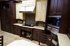 www.faceyourkitchen.com Love the dark wood in this French inspired kitchen!