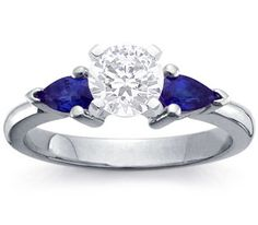 Engagement ring with sapphire side stones-- maybe a different stone on the sides black diamonds??