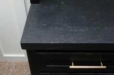 If you saw the man cave built-ins makeover a couple of weeks ago, you may have noticed that the countertop was sporting a black finish—in particular a black faux stone finish.
