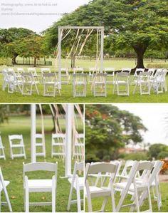 Gorgeous ribbon draped wedding ceremony arch with circular seating for New Farm Park wedding, Brisbane. www.brisbaneweddingdecorators.com.au