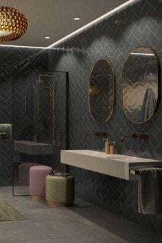 Mooie moderne badkamer inspiratie met een betonlook grijze vloertegel en een zwarte visgraat wandtegel gevoegd met licht grijze voeg. Een ruime inloopdouche met douchewand met zwart profiel en een mat gouden opbouw regendouchekraan. Een marmer wastafel met twee inbouw waskommen. Twee inbouw wastafelkranen en twee ovale spiegel met een mat gouden rand. Een handdoekhouder mat goud met twee kleurige poefjes en een leuke lamp. #mincobadkamer #skypejebadkamer #badkamerinspiratie Bathroom Design Inspiration, Bathroom Inspo, Basement Bathroom, Modern Bathroom Design, Bath Design, Bathroom Interior Design, Small Bathroom, Living Room Wall Designs, Home Design Decor
