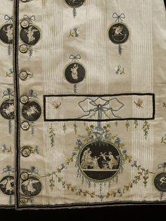Waistcoat, England, 1780-1790, Silk backed linen. Neo-classical design is evident in the decoration of this waistcoat of the 1780s. Embroidered floral garlands and ribbons, elements of late-18th century decoration, adorn the pockets. Medallions of twill silk minutely and skilfully painted in black with mythological classical figures have been applied to the front and collar. The square-cut shape, standing collar and welt pocket are characteristic of the waistcoat styles in the 1780s.