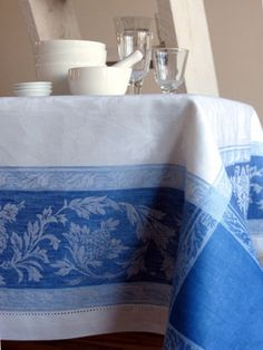 I love the french linen table cloths with woven jacquard pattern from this era.... blue, red, green, etc.