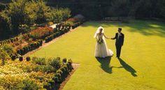 Bride and groom in the lower garden of Brantwyn Mansion in Wilmington, DE  www.DuPontCountryclub.com/weddings