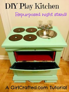 Repurposed upcycled night stand turned into a play kitchen, DIY tutorial!   GirlCrafted.com