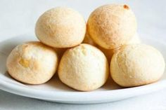 Brazilian Cheese Bread (Pao de Queijo) Recipe note: needs more rolling, very sticky, move from bottom rack halfway through. Raw Food Recipes, Gluten Free Recipes, Paleo Recipes, Bread Recipes, Yummy Recipes, Brazilian Cheese Bread, Sem Gluten Sem Lactose, International Recipes, Portuguese Recipes