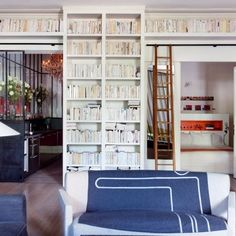 Bookshelves with doors cut out Bookshelf Room Divider, Bibliotheque Design, French Apartment, Appartement Design, Shelving Systems, Home Libraries, Paris Apartments, Beautiful Interiors, Built Ins