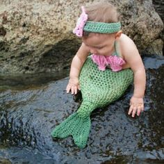 merbaby - so cute, but POOR BABY because she can't kick around.  My Granny would have cut me out of that thing if she saw me in it!