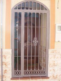 Puertas con arco de hierro forjado google search rejas - Cancelas de hierro ...
