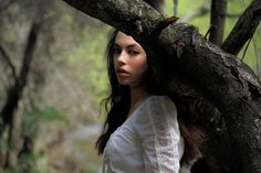 She hid behind a tree to catch her breath but she knew if she didn't keep moving they would find her. She took a quick glance over her shoulder before she continued running.