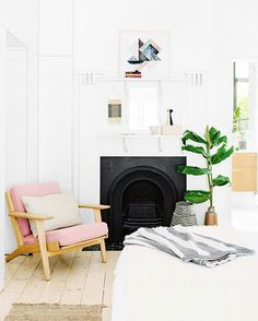 The blush detail on this room is stunning. Fireplace.