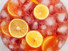 aperol gin punch - gin, aperol, yellow chartreuse, lime juice, grapefruit juice, orange juice, orange bitters, sparkling wine