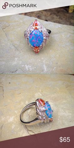 sterling silver filled blue opal cz morganite ring Fiery blue opal and morganite cz in a sterling silver filled setting. The opal is lab created. Jewelry Rings
